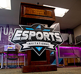 Photo of America East podium at Esports Invitational press conference.