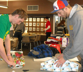 UAlbany students wrap gifts