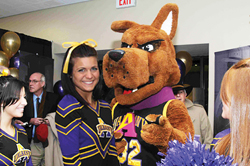 UAlbany cheerleader and Great Dane mascot.