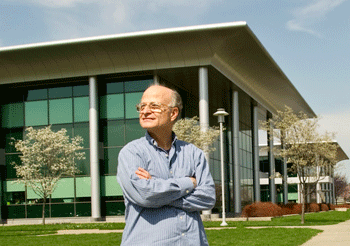Professor Paul F. Agris standing in front of the Life Sciences Research Building