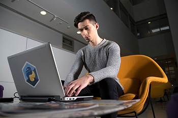UAlbany senior Aleks Siemenn views his climate modeling on a laptop in University Hall.