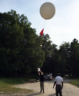 ASRC researchers prepare to launch a weather balloon over the Long Island Sound.