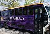 UAlbany's newly wrapped shuttle bus.
