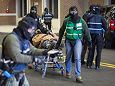 First responders carry a man on stretcher during active shooter training at the New York State Preparedness Training Center in Oriskany, N.Y.