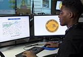 UAlbany student works on computer at NYS Emergency Operations Center