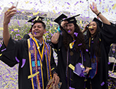 Students celebrate as confetti falls at UAlbany's 2018 undergraduate commencement ceremony.