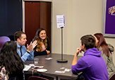 """Students network with alum Mike Nolan '12, '17 at """"Speed DANE-ING"""" event."""