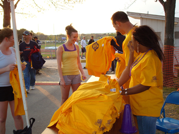 Handing out T-shirts at the Spring Stomp.