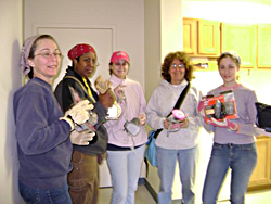 Five SPH volunteers cleaned up damage inside a house on a previous trip.