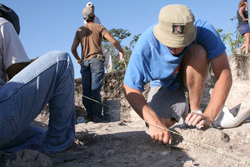 UAlbany student on archaeological dig.