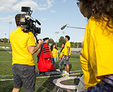 Nyasha, Melick and Sharinel meet President Havidán Rodríguez at Tom & Mary Casey Stadium during the filming of Ellen's docuseries.