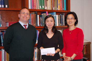 From left, Brian Keough (head of Special Collections), award winner Eugenia Kim, and sponsoring professor Dr. Donghee Sinn.