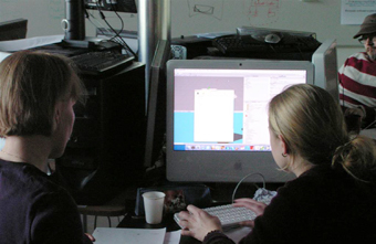 Student creating a game on the computer