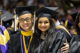 UAlbany graduate students take photo at their commencement.