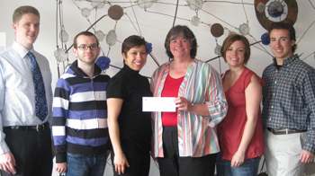 SPH students present check to Equinox.