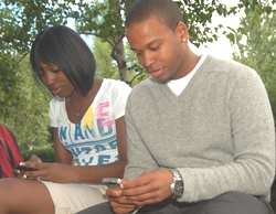 Students checking cell phone messages