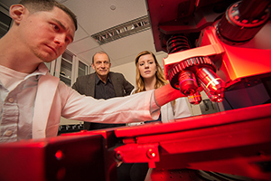 UAlbany Chemistry Professor Igor Lednev works with Ph.D. candidates Claire Muro and Kyle Doty.