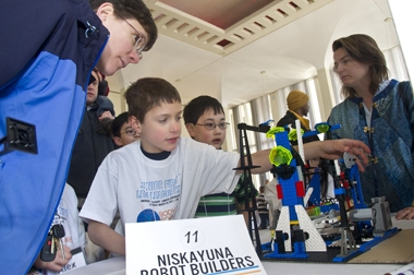 Team members with Lego construction at Junior FIRST Lego League Expo at UAlbany