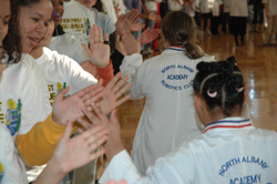 High-fives all around at the Junior FIRST Lego League (JFLL) Expo