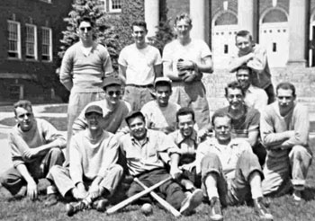 Harvey Milk second from right second row kneeling at the NYS College for Teachers (UAlbany) with his softball team