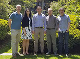 DAES researchers awarded NSF grant dollars take group photo on Uptown Campus Podium.