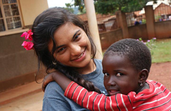UAlbany student Nishtha Modi assists building a school for children with AIDS in Uganda