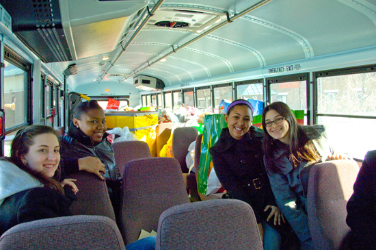 UAlbany students deliver a busload of gifts