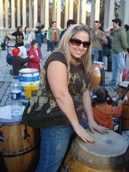 Jocelynn Rizzi plays the drums in Retiro Park in Spain.