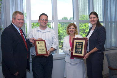 Nick Fahrenkopf and Vice President for Student Success Christine Bouchard, second and third from left, receive plaques from the American Red Cross.