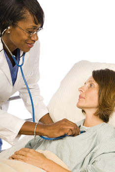 A medical professional listens to a patient's heartbeat