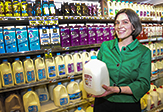 Historian Kendra Smith-Howard holding a gallon of milk