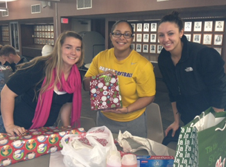 UAlbany's softball team wraps presents for disadvantaged children