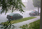 Photo of cars on the road during severe hailstorm.