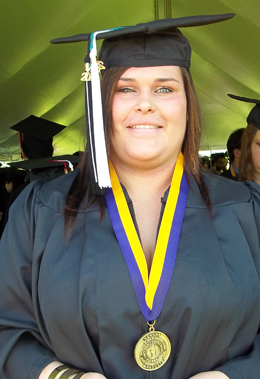 Brittni Gulotty, in her cap and gown at Commencement