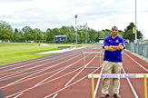 Coach Roberto Vives, at home away from home, on the University at Albany track