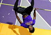 An upside-down star high jumper Matthew Campbell clears the bar