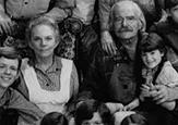 "Grandma and Grandpa Walton, surrounded by the Walton ""family"""