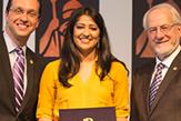 Hirah Mir accepts an award.