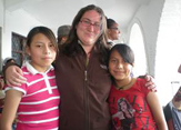 Aline Heffernan with children in Ecuador