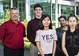 Tom Begley stands with four of the newest RNA Fellows