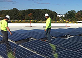 Solar panels being installed at the Campus Center West addition.