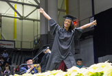 A grad celebrates during Winter Commencement 2015. (Photo by Mark Schmidt)