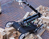 robot climbing over pieces of wood