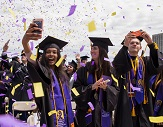 Students celebrate UAlbany's 2017 undergrad commencement.