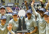UAlbany women's basketball team with America East trophy.