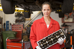 Woman studying to be a mechanic