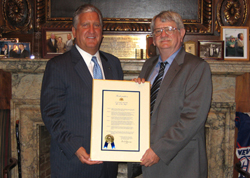 Albany Mayor Gerald D. Jennings honored UAlbany professor Michael R. Werner.