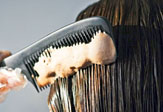 Woman combing her hair.