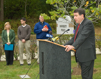 President George M. Philip speaks during a remembrance ceremony for student Richard Bailey.
