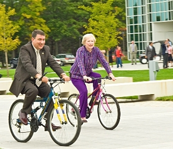 SUNY Chancellor Nancy Zimpher and UAlbany President George Philip take a bike ride on campus to promote sustainability.